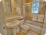 1st floor master bath with marble floors limestone shower
