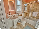 queen suite bathroom upstairs. Marble floors, limestone showers, pedestal sinks.