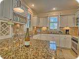 its 5 oclock somewhere. Cute kitchen with granite and stainless, marble floors.