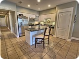 Chefs kitchen, marble floors, stainless appliances, high end cookware