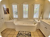 opulent master bath with jacuzzi tub, separate shower